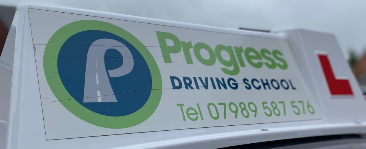 Roofbox on top of learner driver car says Progess Driving School